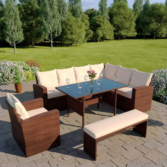 The Aruba 9 seater rattan corner dining set with arm chair and bench in mixed grey with light cushions