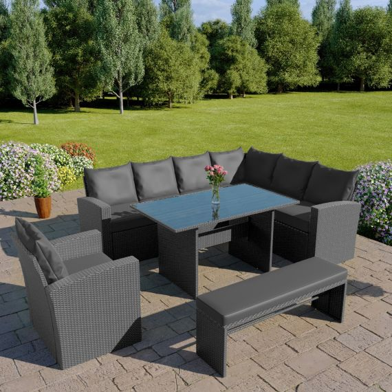 The Aruba 9 seater rattan corner dining set with arm chair and bench in solid grey with dark cushions