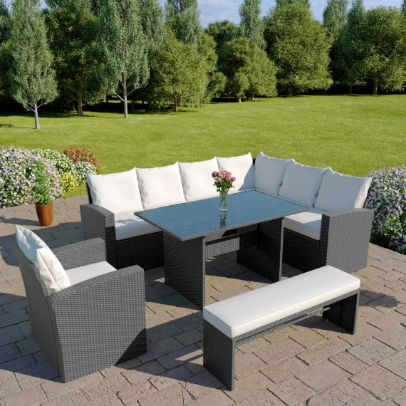 The Aruba 9 seater rattan corner dining set with arm chair and bench in solid grey with light cushions