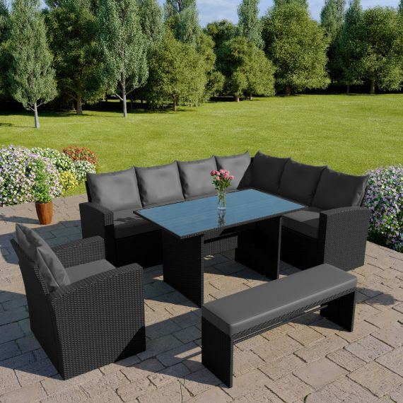 The Aruba 9 seater rattan corner dining set with arm chair and bench in black with dark cushions