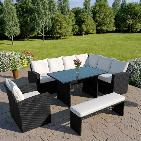 The Aruba 9 seater rattan corner dining set with arm chair and bench in black with light cushions