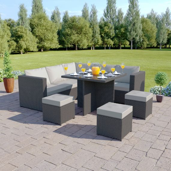 The Valencia 7 Seat Rattan Corner Sofa Dining Set in Grey with Light Cushions